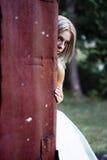 Bride hiding Stock Photography