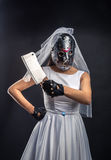 Bride in hockey mask with meat cleaver. Serial murederer in wedding dress Royalty Free Stock Image