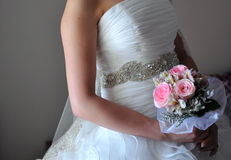 Bride hold bouquet Stock Image