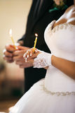 Bride hold a candle. Royalty Free Stock Images