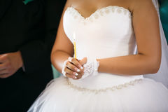 Bride hold a candle. Royalty Free Stock Photography