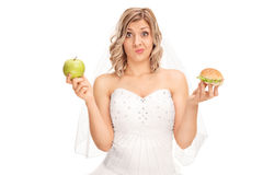 Free Bride Holding An Apple And A Hamburger Stock Photo - 64181170