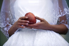 Bride holding apple Stock Image