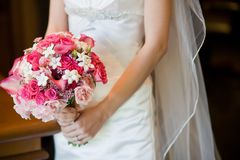 Bridal bouquet. Bridal wedding bouquet consisting of light pink roses, hot pink roses, pink calla lilies, and stephanotis pink wax flower stock photo