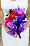 Bride with bouquet of flowers at wedding Stock Photo