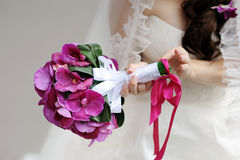 Bride holding beautiful bridal bouquet Royalty Free Stock Photo