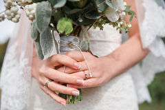 Bride holding a beautiful bridal bouquet Stock Image