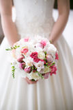 Bride is holding a beautiful delicate bridal bouquet Royalty Free Stock Image