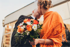 Bride holding beautiful orange wedding flowers bouquet Stock Image