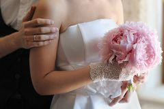Bride holding beautiful wedding bouquet Stock Image
