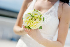 Bride holding beautiful wedding bouquet Royalty Free Stock Images
