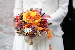 Bride holding beautiful wedding bouquet Royalty Free Stock Photography