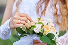 Bride holding a beautiful wedding bouquet Royalty Free Stock Images