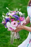 Bride holding beautiful wedding bouquet Stock Image