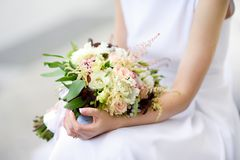 Bride holding a beautiful wedding bouquet Stock Photography