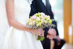 Bride holding a beautiful wedding bouquet Royalty Free Stock Image