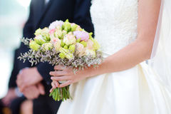 Bride holding a beautiful wedding bouquet Stock Photo