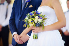 Bride holding a beautiful wedding bouquet Royalty Free Stock Photos