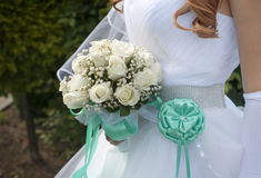 Bride holding beautiful wedding bouquet of roses Royalty Free Stock Photos