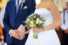 Bride holding a beautiful wedding bouquet on wedding day Stock Photography