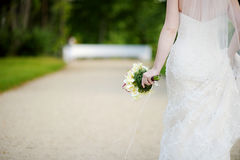 Bride holding beautiful wedding bouquet. Bride holding beautiful white wedding flowers bouquet Stock Photography