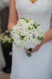 Bride holding a beautiful wedding bouquet of white flowers.  Royalty Free Stock Photos