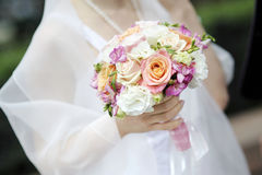 Bride holding beautiful wedding flowers bouquet Royalty Free Stock Image