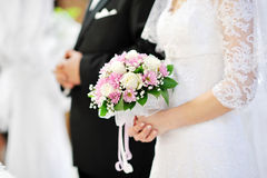 Bride holding beautiful wedding flowers bouquet. Bride holding beautiful pink wedding flowers bouquet royalty free stock photos
