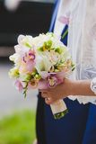 Bride holding beautiful wedding flowers bouquet. Bride holding beautiful pink wedding flowers bouquet Stock Photography