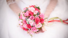 Bride holding beautiful wedding flowers bouquet. Bride's hands holding beautiful wedding flowers bouquet Royalty Free Stock Photo