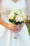 Bride holding a beautiful white wedding bouquet Stock Photo