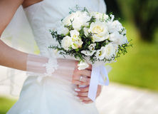 Bride holding a beautiful white wedding bouquet Royalty Free Stock Photo