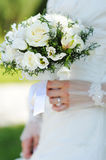 Bride holding a beautiful white wedding bouquet.  Royalty Free Stock Photography