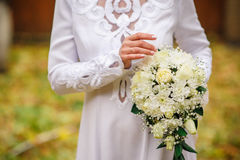 Bride holding beautiful white wedding bouquet.  Royalty Free Stock Photography