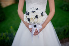 Bride holding beautiful white wedding bouquet in hands.  Stock Photo
