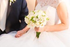 Bride holding big bridal bouquet on wedding ceremony Stock Images