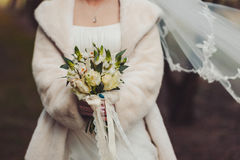 Bride holding big wedding bouquet on wedding ceremony Royalty Free Stock Photo