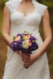 Bride holding big wedding bouquet on wedding ceremony Stock Images