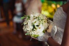 Bride holding big wedding bouquet on wedding ceremony Stock Photos