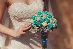 Bride holding big wedding bouquet on wedding ceremony Stock Photo