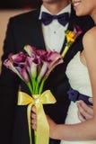 Bride holding big wedding bouquet on wedding ceremony Royalty Free Stock Images