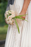 Bride holding bouguet of flowers Royalty Free Stock Photography