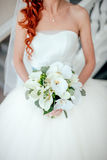 Bride holding bouguet of flowers Stock Images