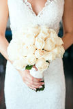 Bride holding bouguet of flowers Stock Photography