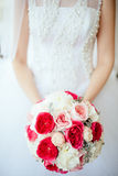 Bride holding bouguet of flowers Stock Image