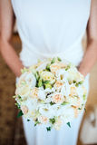 Bride holding bouguet of flowers Stock Photo