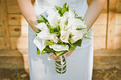 Bride holding a bouqet of calla lilies Stock Photo