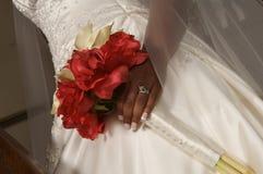 Bride holding bouquet Stock Images