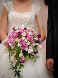 Bride holding bouquet Stock Photo