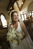 Bride holding bouquet. royalty free stock photography